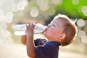 Little boy drinking from a water bottle
