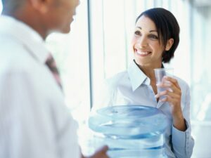 Two people at the office water cooler
