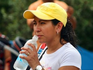 Woman drinks bottled water from Brisbane vendor